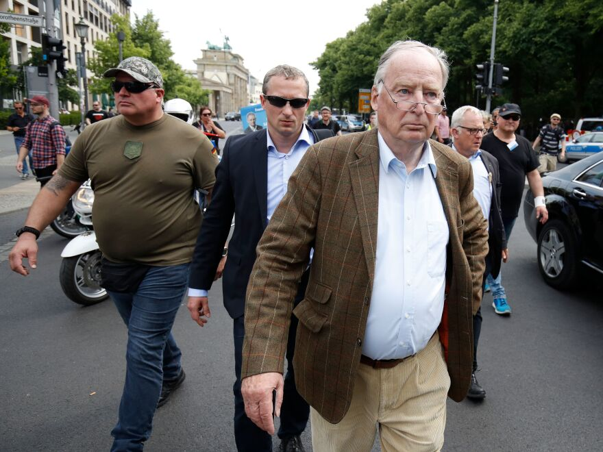 """Alexander Gauland walks from the Brandenburg Gate to the Bundestag in Berlin after he delivered a speech during the """"demonstration for the future of Germany"""" called by the far-right AfD in Berlin on May 27. Last weekend, Gauland caused outrage in Germany when he called the Nazi era """"just a speck of bird s*** in more than 1,000 years of successful German history."""""""