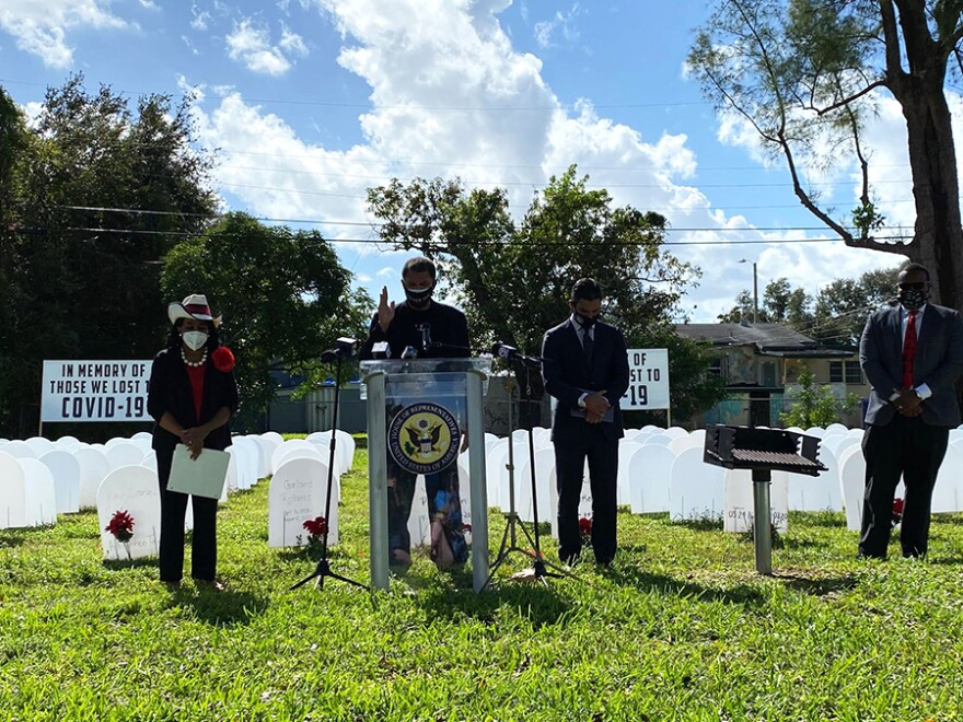 Pastor Richard P. Dunn II of Miami led a prayer at the Simonhoff Park in Liberty City to commemorate all of the people who've died in Miami-Dade County from COVID-19. He had and recovered from COVID-19 earlier this year and offered testing at his church in October. U.S. Congresswoman Frederica Wilson stands to the left and Miami Mayor Francis Suarez to the immediate right.