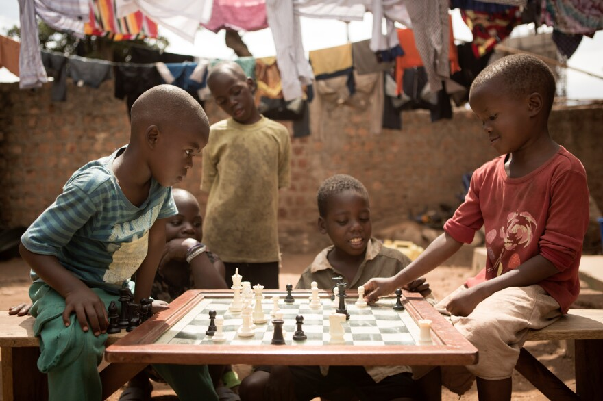 Children make their moves at the Katwe Chess Academy, located in a slum in Kampala, Uganda. The Academy is where Phiona Mutesi, whose story is the basis for the movie <em>Queen of Katwe,</em> learned to play.