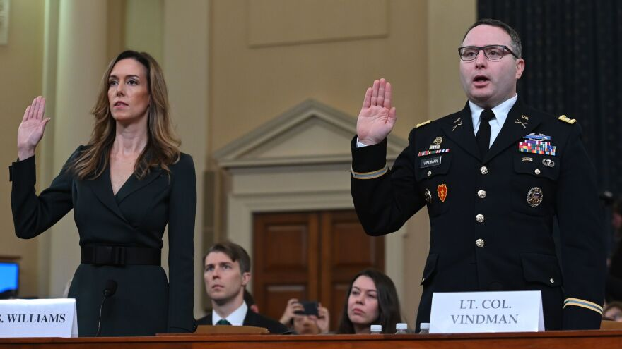 Jennifer Williams and Lt. Col. Alexander Vindman take the oath before testifying during the House Intelligence Committee hearing on Tuesday.