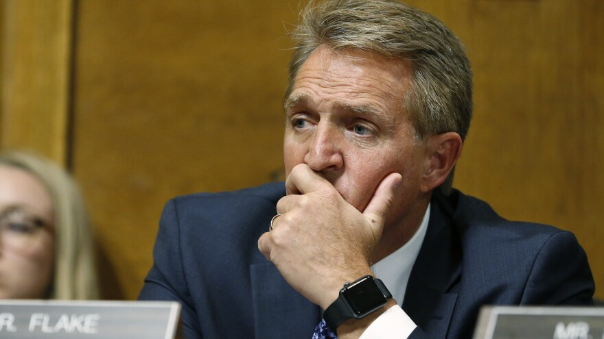 Sen. Jeff Flake, R-Ariz., listens as Christine Blasey Ford testifies before the Senate Judiciary Committee on Thursday.