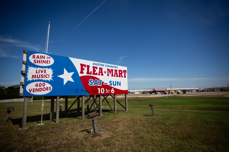 A sign for Austin Country Flea Market says the market has 400 vendors and live music.