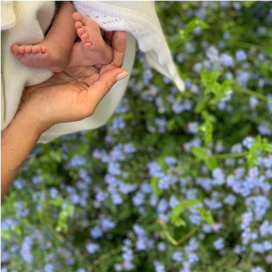Meghan Markle holds the feet of her baby, Archie Harrison Mountbatten-Windsor. Prince Harry and Markle, the Duchess of Sussex, have released a photo of their newborn baby to mark Markle's first Mother's Day as a mom.