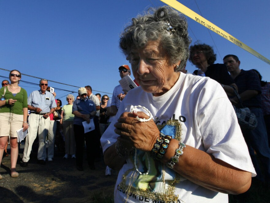 Anita Gisbert prays underneath police tape surrounding LeRoy Carhart's abortion clinic in Germantown, Md. in July. The Justice Department has increased enforcement of laws that prevent protesters from blocking access to clinics.