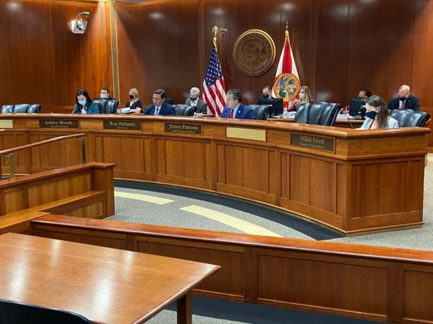 Gov. Ron DeSantis with members of the Florida Cabinet during a meeting.