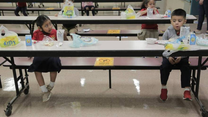 Students enjoy breakfast in the cafeteria at Redland Elementary on the first day of Miami-Dade public schools' reopening.