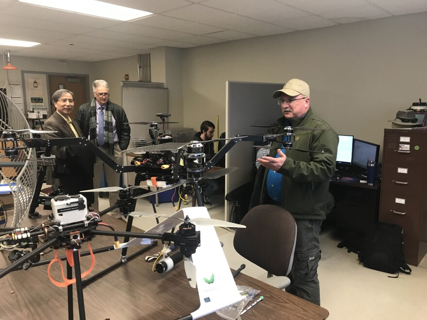 Missouri S&T's Mark Bookout stands near one of the drones being tested to help inspect and repair bridges.