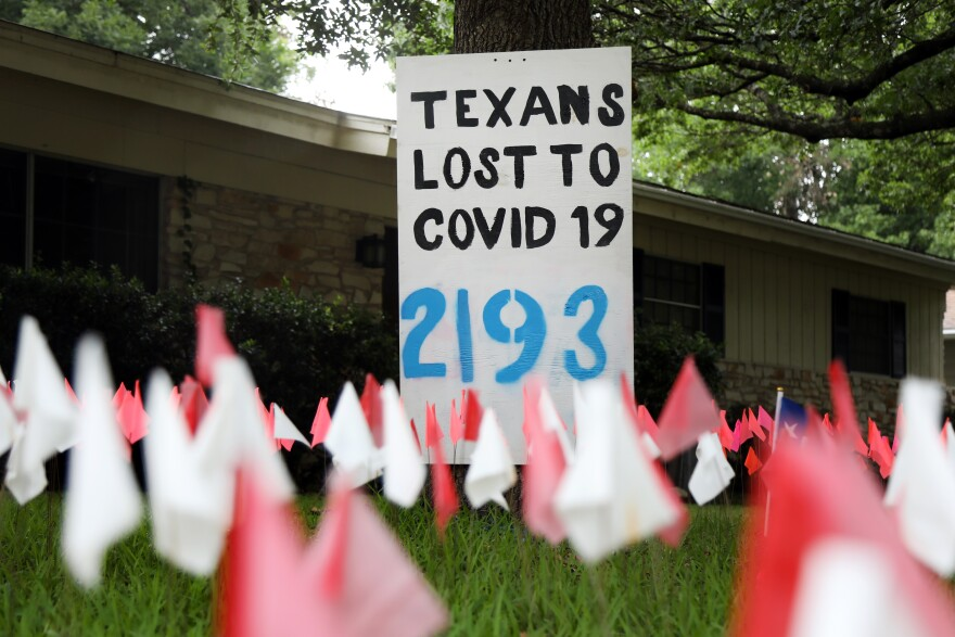 Flags mark the number of COVID-19-related deaths in Texas.