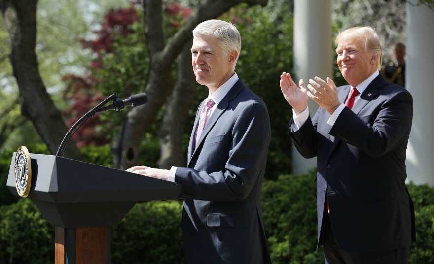 President Trump applauds as Supreme Court Associate Justice Neil Gorsuch delivers remarks after taking the judicial oath in a ceremony at the White House Rose Garden in April 2017. Getting a justice appointed to the court was a key campaign promise for Trump.