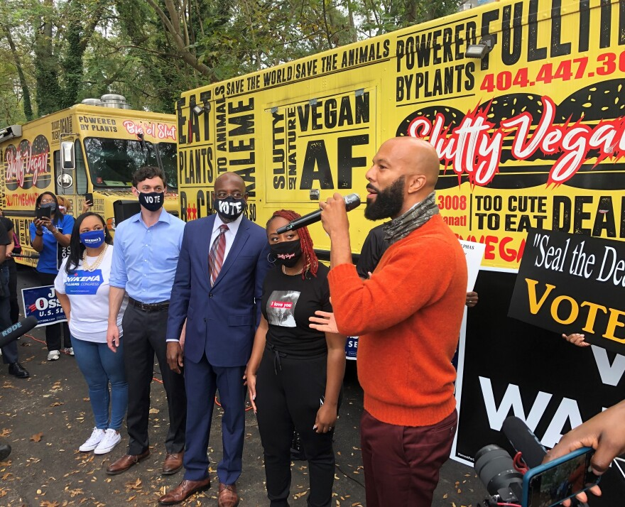 Democratic Senate Candidate Rev. Raphael Warnock, center, at GOTV rally in Jonesboro, Ga., with the rapper Common.