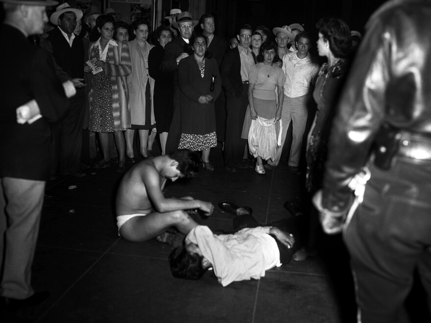During the Zoot Suit Riots of 1943, white servicemen and police stripped young Mexican-American men of their clothes. Zoot Suits, flamboyant and flowing, were seen as symbols of a violent pachucho culture and as unpatriotic during wartime rationing.