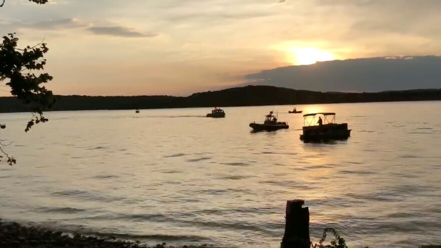 "Rescue personnel work after an amphibious ""duck boat"" capsized and sank, at Table Rock Lake near Branson, Mo., on Thursday."