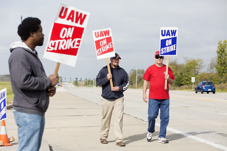 Auto workers Antonio Harris, Scott Whitman and Mike Harris, left to right, picket outside the Wentzville GM plant. Oct. 15, 2019