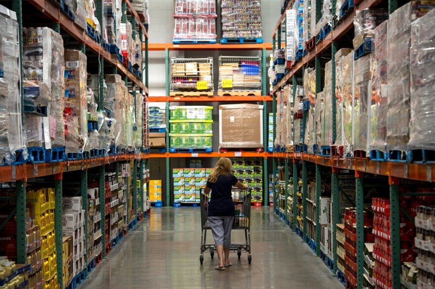 A woman pushes a cart at a Costco store in Hackensack, N.J., in 2013. Big-box stores are effective delivery devices for fattening foods, economists argue in a new study.