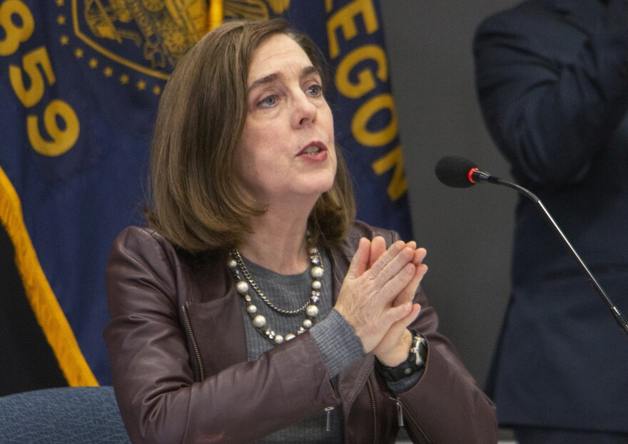 Oregon Gov. Kate Brown (shown here on Nov. 10) has ordered new statewide restrictions to head off a resurgence in coronavirus cases.