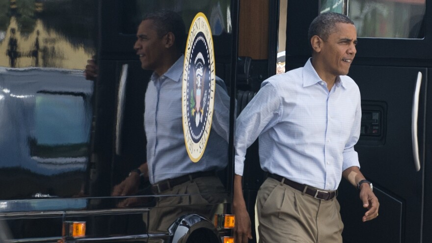 "President Obama steps off his bus, nicknamed ""Ground Force One,"" as he arrives for breakfast at the Ossorio Bakery and Cafe in Cocoa, Fla., during a two-day bus tour last year."