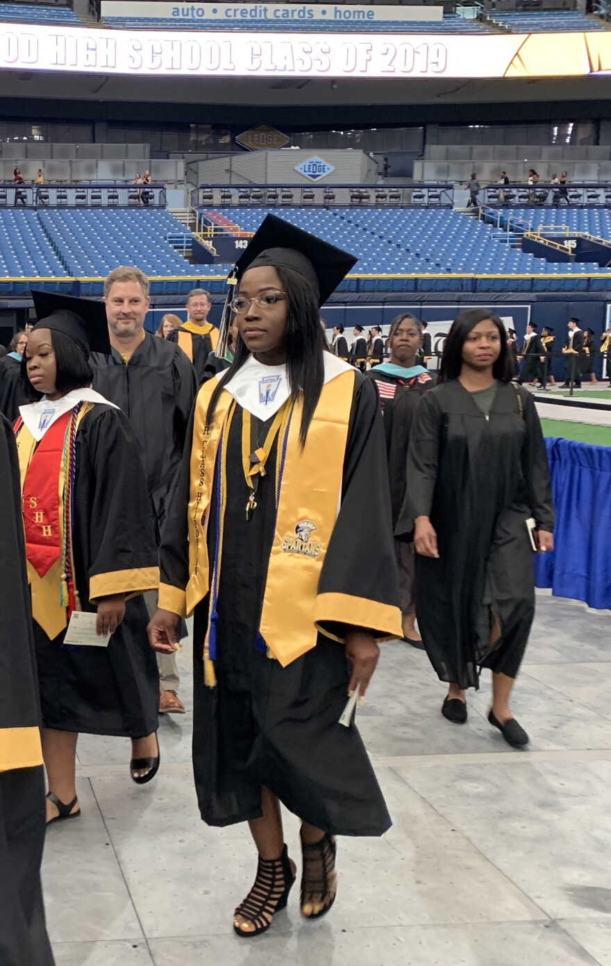 High school graduates walk to stage