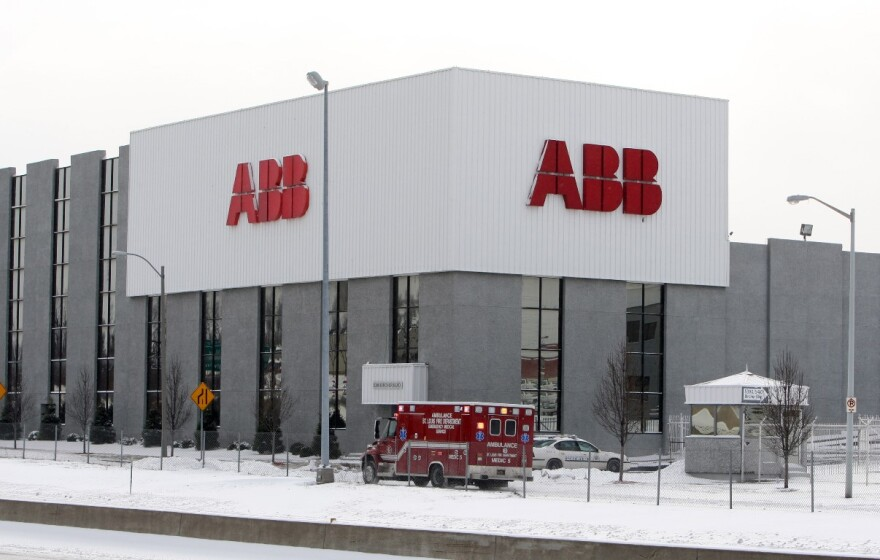 An ambulance leaves the scene of a mass shooting at ABB on Jan. 7, 2010.