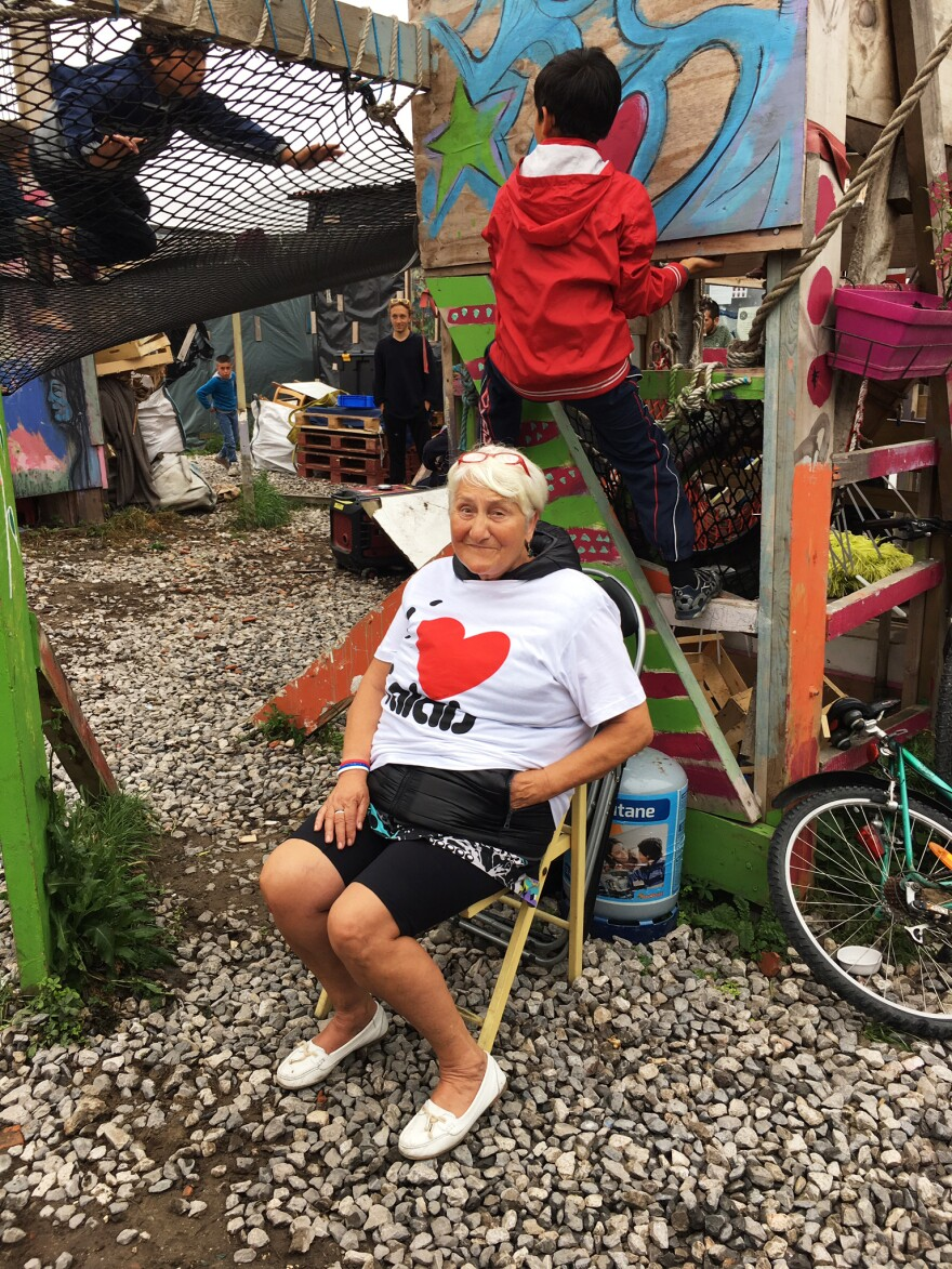 """Wearing an """"I Heart Calais"""" T-shirt, Nicole Cordier visits a part of The Jungle where children can play. Some at the camp ask how she got a small cut on her knee. """"No one in Calais ever asked me about that,"""" she says."""