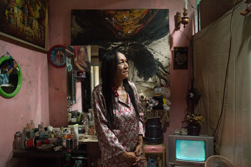 Ningsih Iskander, 45, stands in her room in an informal housing complex where several waria live in Yogyakarta. She's also a busker, singing at night for tips.