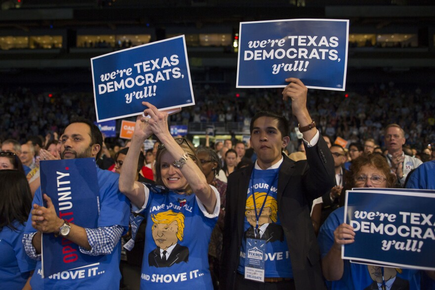 Participants rally on the floor of the Texas Democratic Convention in San Antonio in 2016.