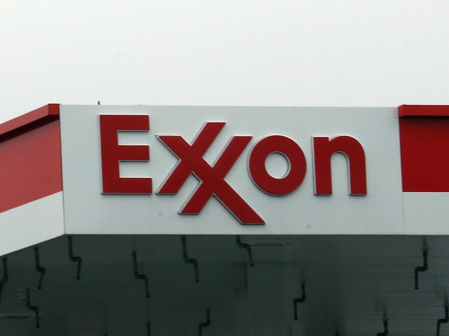 An Exxon station in Hicksville, N.Y., in March. Exxon Mobil Corp. announced up to $20 billion in write-downs of natural gas assets, the biggest such action ever by the company.