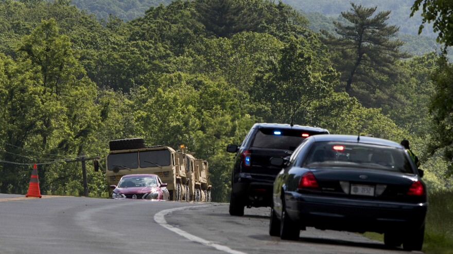 Military vehicles sit alongside Route 293 in New York, near the area where a personnel vehicle reportedly overturned. One cadet died in the accident, West Point says.