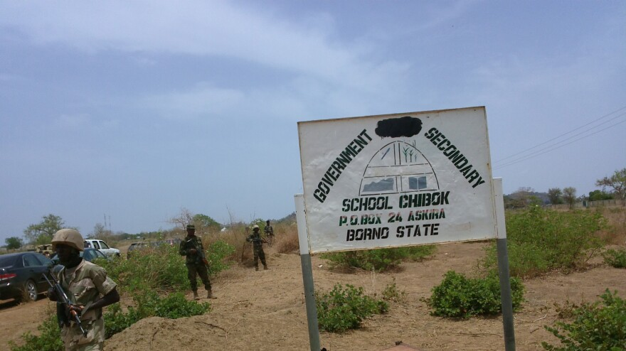 Soldiers stand guard in front of the government secondary school Chibok in 2014 in Chibok, Nigeria.