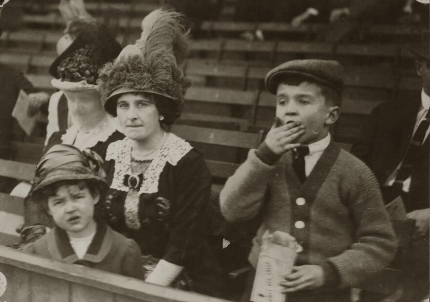 Helene Britton in the baseball stands with her children, Marie and Frank DeHaas Britton. She sold the St. Louis Cardinals in 1918, before being able to pass the team to her son.