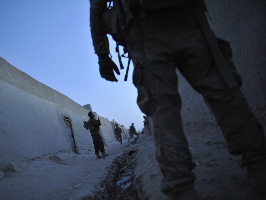 U.S. troops and Afghan National Army soldiers on a joint security patrol in Kandahar province last August.