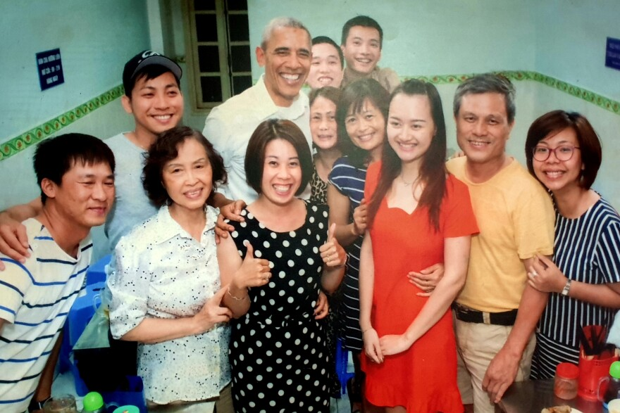 """Nguyen Manh Hung (2nd right), the owner of a Hanoi coffee shop, posed for this photo with President Obama and others during Obama's 2016 visit to Vietnam. He thinks Kim Jong Un should learn from Vietnam's example and make peace with the U.S. """"They will have to do that to survive, because the North Korean people have suffered abject poverty for so long, just as we did,"""" he says."""