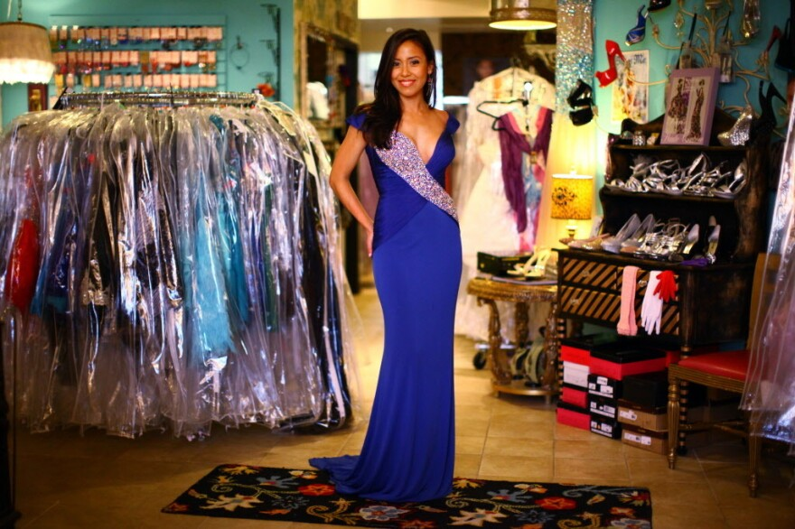 Jessica Bermudez, 24, models a dress at Deja Vu in Alexandria, Va. Bermudez is competing for the title of Miss District of Columbia USA, and says she regularly enters beauty pageants.