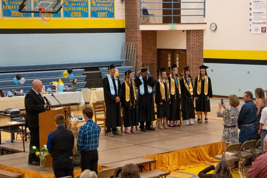 <strong>A Tiny Ceremony:</strong> Superintendent Charles Auzqui, left, congratulates the small graduating class at Clearmont Elementary, Arvada-Clearmont Junior and Senior High School in Clearmont, Wyoming.