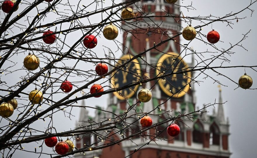 Christmas decorations hang in front of the Spasskaya Tower of the Kremlin in the Red Square downtown Moscow. Russian intelligence agencies are behind a newly-discovered extensive hack of at least five U.S. government agencies.