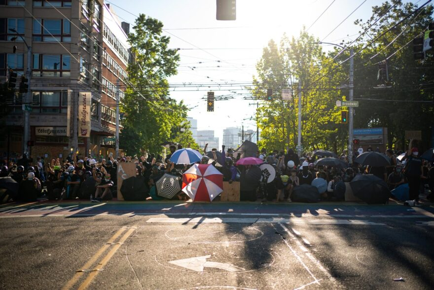 Demonstrators fill an intersection near Seattle Central College during Seattle's racial justice protests, Peaceful demonstrations took place following reports that federal agents may have been sent to the city.
