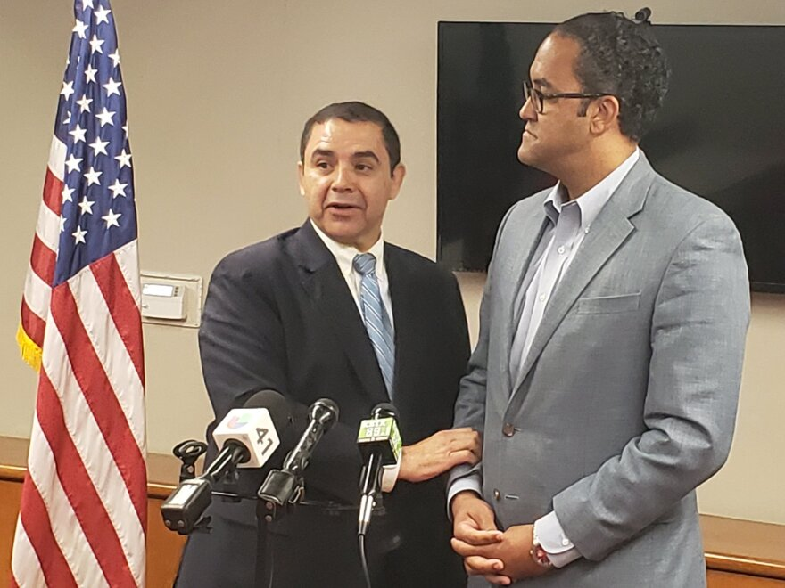 Congressmen Henry Cuellar (D) and Will Hurd (R) speak at a press conference about border crossings in August 2019.