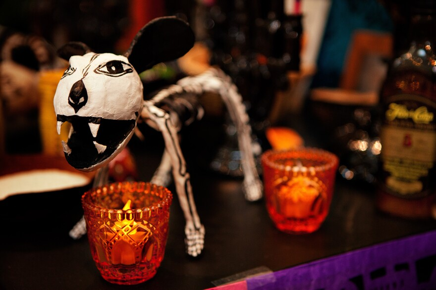 Dogs and Candles: Dogs were believed to guide the ancestral spirits to their final resting place in the afterlife but candles represent fire and are a light guiding them back to visit the land of the living.