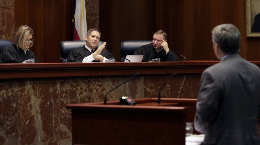 Texas Supreme Court Justice Jeffery Boyd, second from left, asks questions during oral arguments at the Texas Supreme Court in 2015 in Austin.