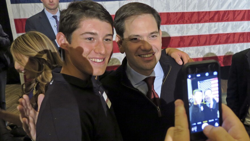 """Florida Sen. Marco Rubio poses for a picture at a Las Vegas rally. One supporter said she's with Rubio over Trump, """"because he's classy."""""""