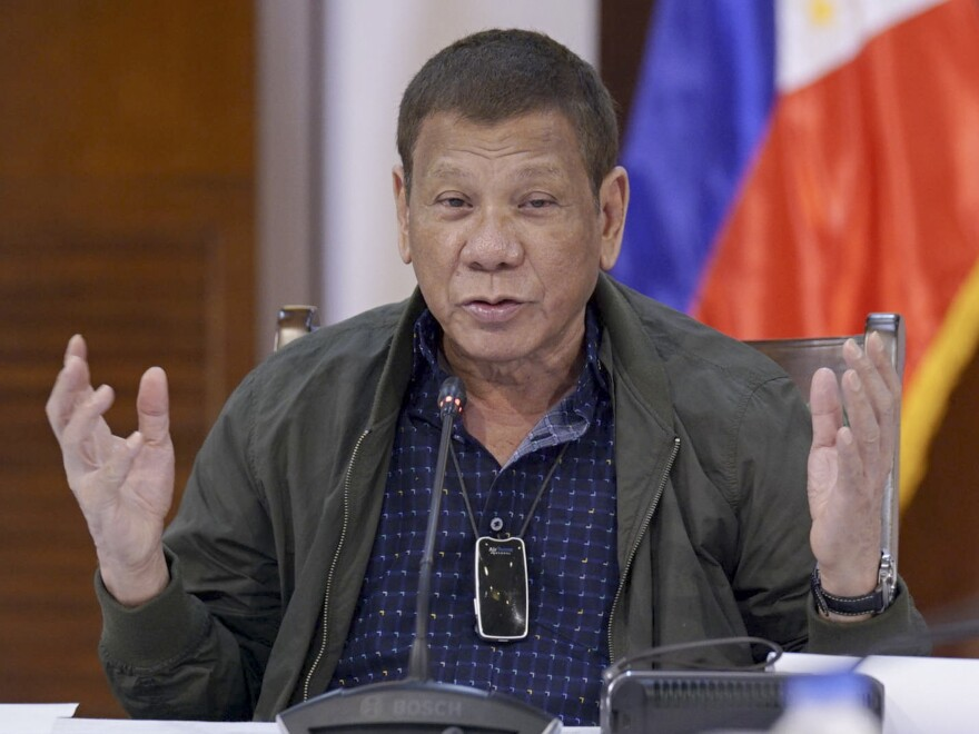 Philippine President Rodrigo Duterte discusses issues related to the new coronavirus during a meeting with an infectious disease task force at the presidential guest house in Panacan, Davao City, southern Philippines, on July 7.
