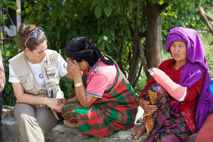 Kelly Suter (left), a nurse with International Medical Corps, counsels a survivor of the earthquake that devastated Nepal last April.