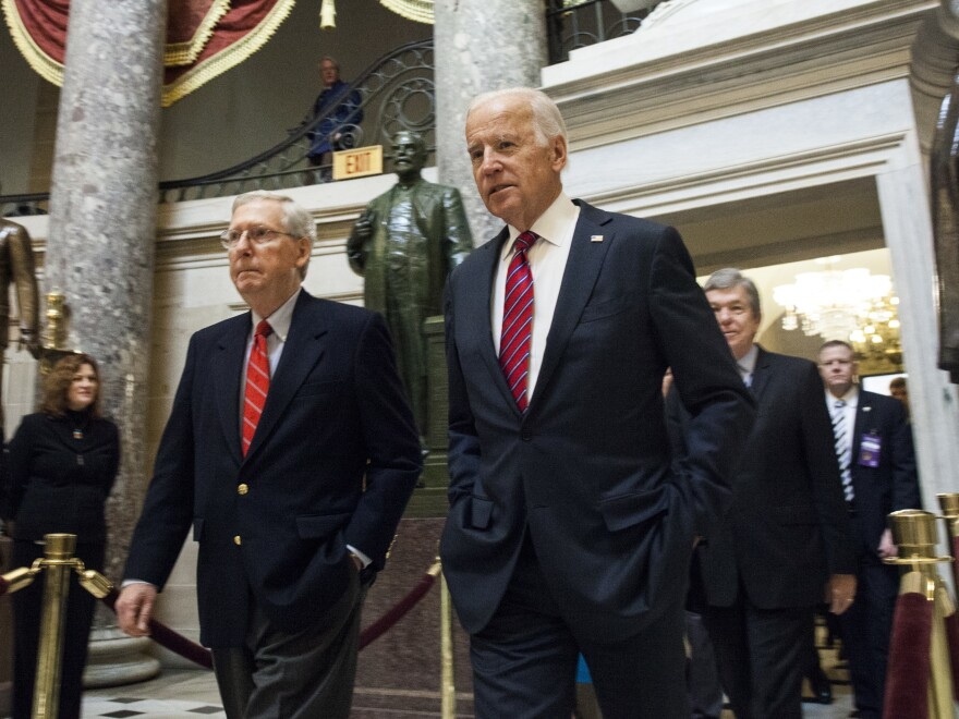 Senate Majority Leader Mitch McConnell and then-Vice President Joe Biden walk through National Statuary Hall on their way to a joint session of Congress on Jan. 6, 2017.
