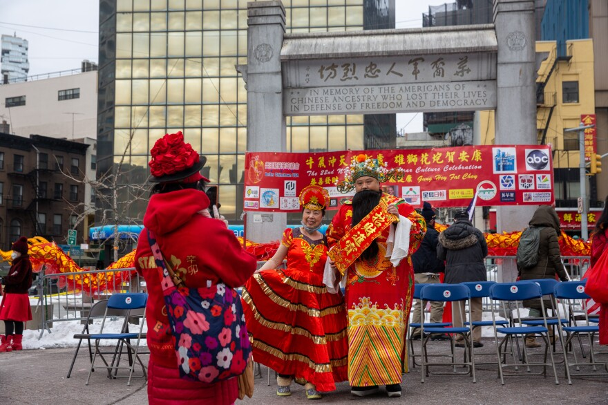 People take photos at the Lunar New Year celebration in Kimlau Memorial Square.
