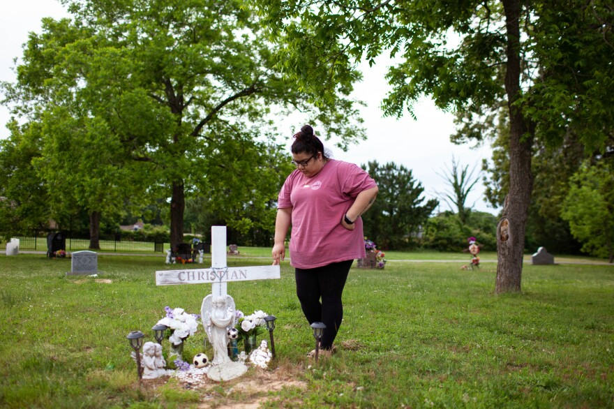 Zaira Gonzalez stands at the grave of her brother, Christian, near her home in Palestine, Texas. Christian died on ranch land in Brooks County, Texas, in September 2012 while crossing illegally into the U.S. from Mexico.
