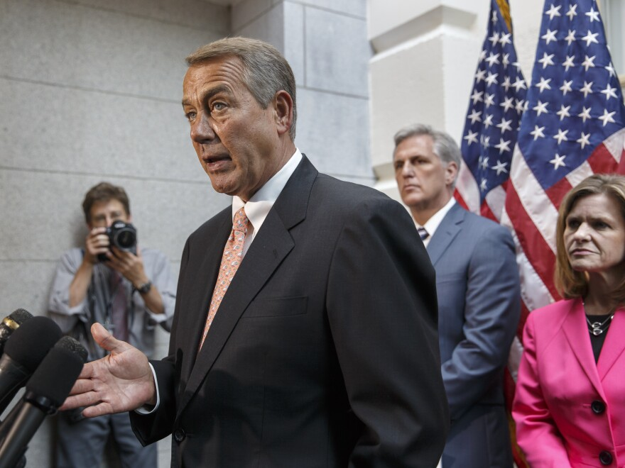 Speaker of the House John Boehner, R-Ohio, with incoming Majority Leader Rep. Kevin McCarthy, R-Calif., and Rep. Lynn Jenkins, R-Kan., talks with reporters on Wednesday about House Republican plans to deal with the border crisis.