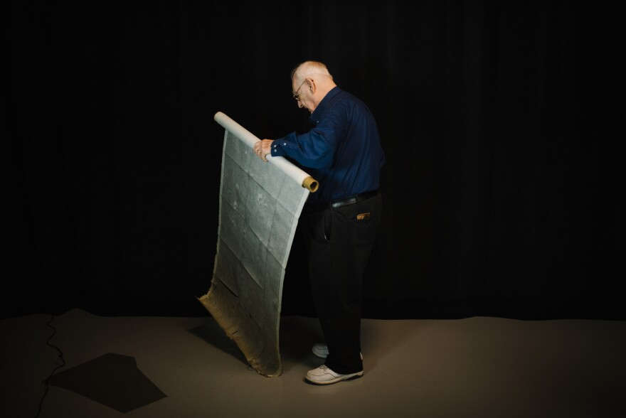Photo of Jim Taylor unrolling map.