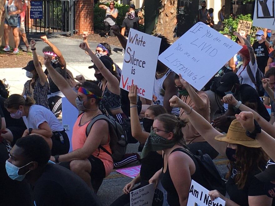 Protesters wore masks as they marched through the streets of South Tampa on Saturday.