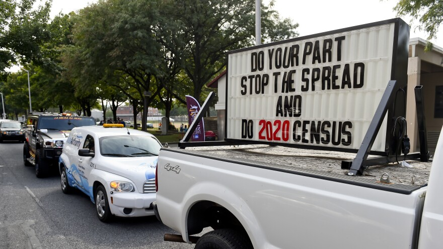 """A sign on the back of a truck promotes 2020 census participation in Reading, Pa. A day after the Census Bureau announced a new """"target date"""" for ending counting efforts, a federal judge in California said she thinks the schedule is """"a violation"""" of her court order."""