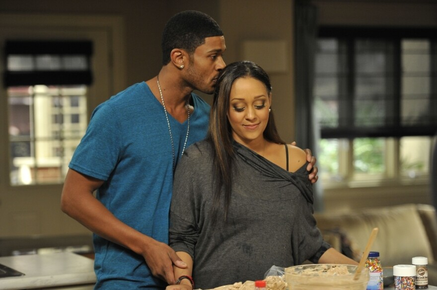 Tia Mowry Hardrict plays Melanie, a doctor whose husband Derwin is a rookie NFL player for the San Diego Sabers. Akil says her goal for <em>The Game</em> was to create relatable characters.