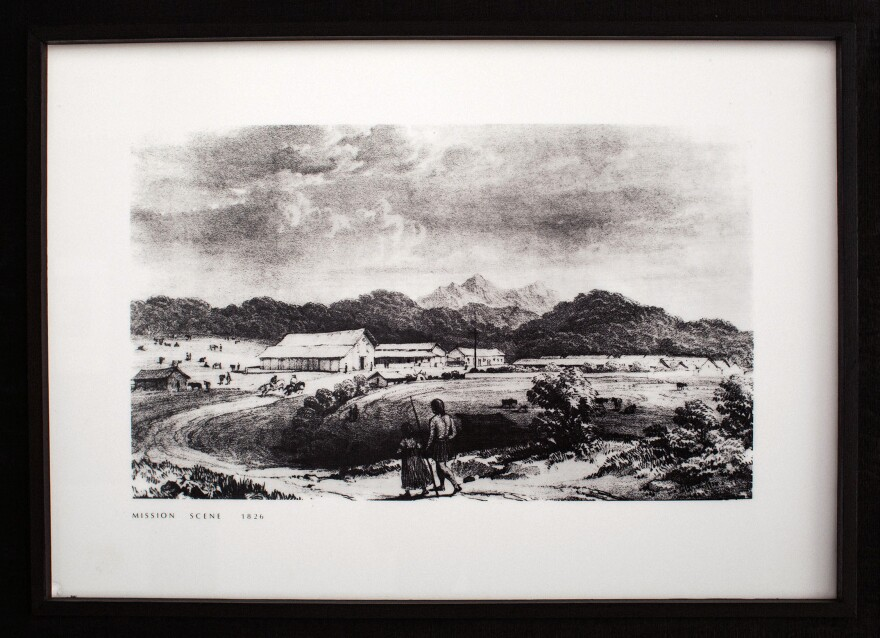 A reproduction of a print of two Indians walking toward Mission Dolores in the 1800s, on display at Mission Dolores.